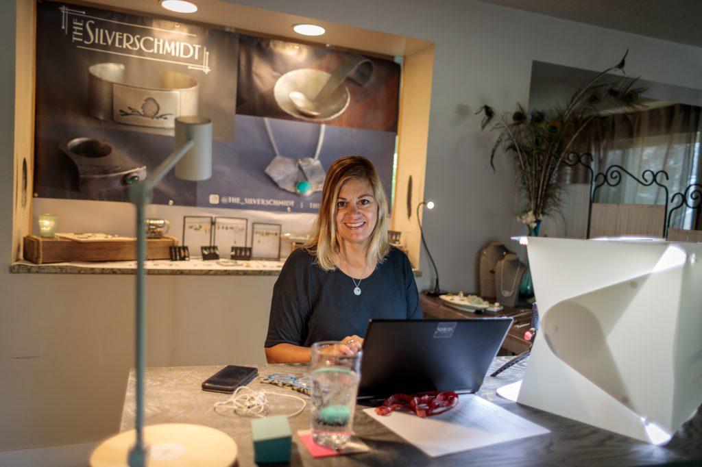 Jewelry Artisan Sitting At Desk